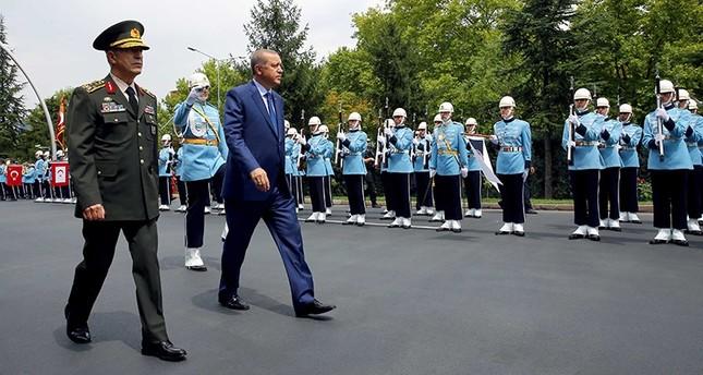 Turkey's President Recep Tayyip Erdoğan (R) and Chief of Staff Gen Hulusi Akar, review a military honor guard at the military headquarters in Ankara, Turkey, on Wednesday, Aug. 3, 2016. (Kayhan Özer / Presidential Press Service, Pool Photo via AP)