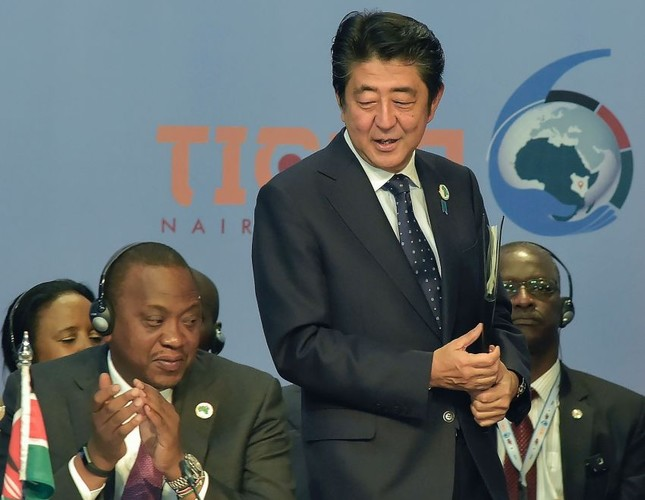 Japanese Prime Minister Shinzo Abe (R) stands next to Kenya's President Uhuru Kenyatta (L) during the opening of the Tokyo International Conference on African Development in Nairobi.