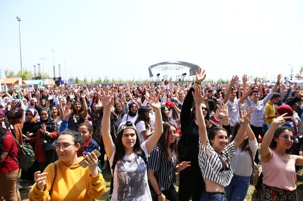 People enjoying a concert on the first day of the festival.