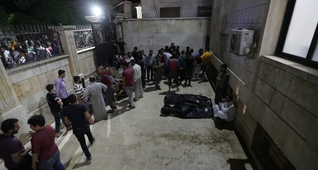 People gather at a site of a car bomb blast in Azaz, Syria June 2, 2019. (Reuters Photo)