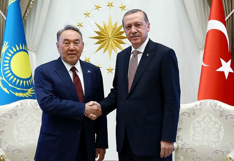 Turkey's President Recep Tayyip Erdou011fan, right, shakes hands with President Nursultan Nazarbayev of Kazakhstan at the Presidential palace in Ankara, Turkey, on Friday, Aug. 5, 2016. (Kayhan u00d6zer/Presidential Press Service, Pool Photo via AP)
