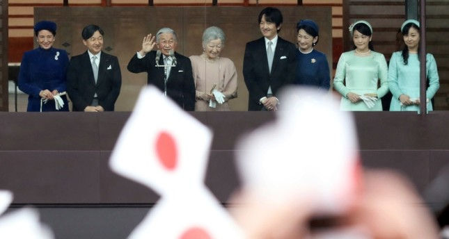 Japan's Emperor Akihito (3L), accompanied by his wife Empress Michiko and their family members, waves to well-wishers as they appear on the balcony of the Imperial Palace to mark the emperor's 85th birthday in Tokyo Sunday, Dec. 23, 2018. (AP Photo)