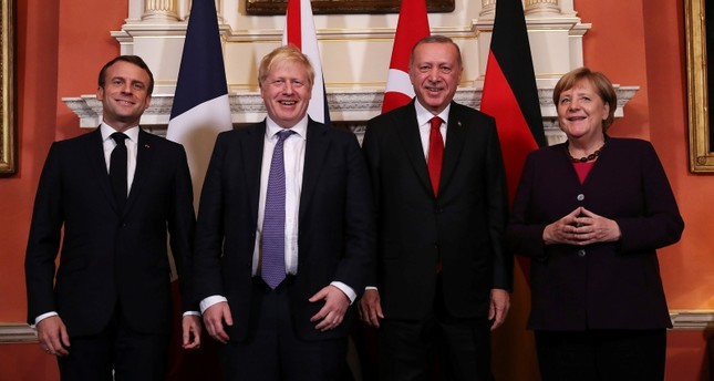 France's President Emmanuel Macron, Britain's Prime Minister Boris Johnson, Turkish President Tayyip Erdogan and German Chancellor Angela Merkel pose as they meet at Downing Street ahead of the NATO summit in London, Britain, December 3, 2019.