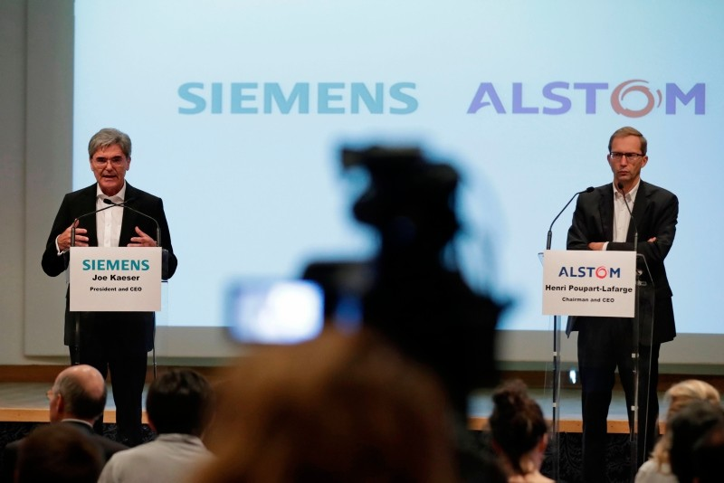 In this file photo from Sept. 27, 2017, German ICE train manufacturing company Siemens President and CEO, Joe Kaeser (L) and French railway transport company Alstom CEO, Henri Poupart-Lafarge speak during a news conference. (AFP Photo)