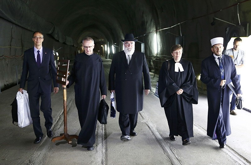 Chief of the Security Division of the Federal Office of Transport Pieter Zeilstra, Father Martin Werlen, Rabbi Marcel Yair Ebel, Reverend Simona Rauch and Imam Bekim Alimi (L-R) arrive for benediction of the NEAT Gotthard Base Tunnel. (Reuters Photo)
