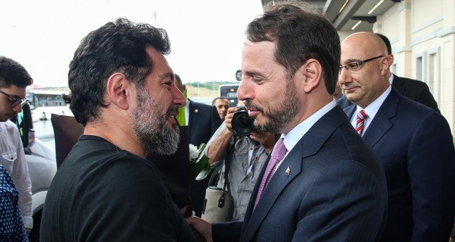 Minister Berat Albayrak greets Hakan Atilla at Istanbul Airport on Wednesday, July 24, 2019 (AA Photo)