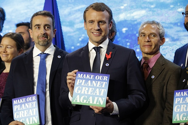French President Emmanuel Macron, center, attends the ,Tech for Planet, event at the ,Station F, start up campus ahead of the One Planet Summit in Paris, France, Monday Dec. 11, 2017. (AP Photo)