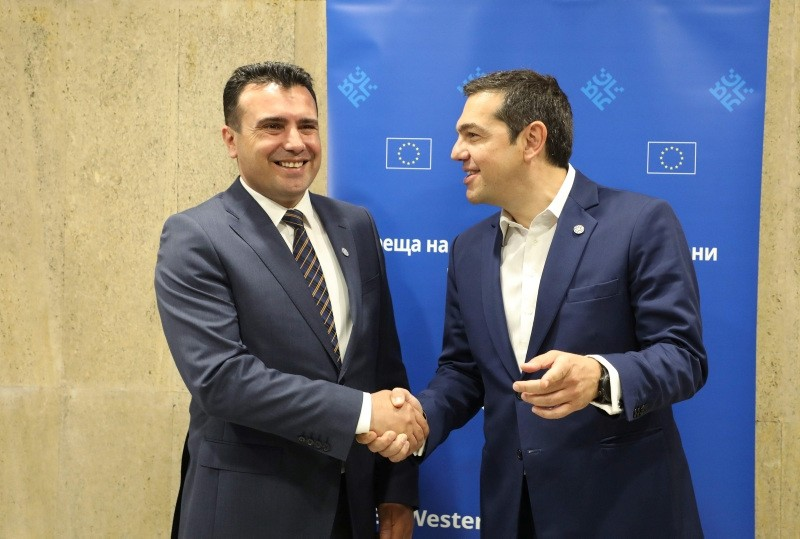 Greece's Prime Minister Alexis Tsipras, right, shakes hands with Macedonia's Prime Minister Zoran Zaev as they meet on the sidelines of the EU-Western Balkans Summit in Sofia, Bulgaria, May 17, 2018. (AFP Photo)