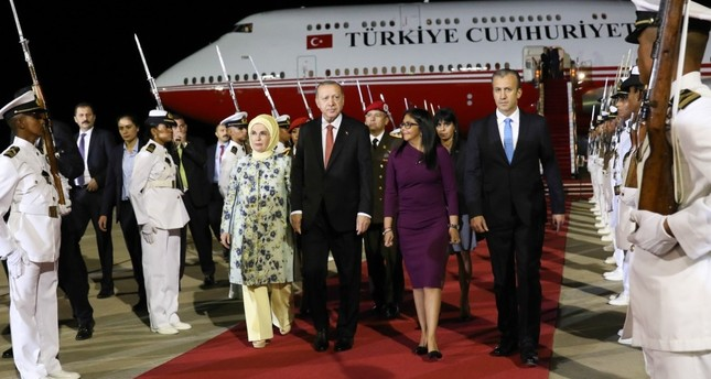 President Recep Tayyip Erdoğan and his wife Emine Erdoğan being welcomed by Venezuelan VP Delcy Rodriguez second right and Industries and National Production Minister Tareck El Aissami right at Simon Bolivar Airport in Caracas, late on Dec. 2.