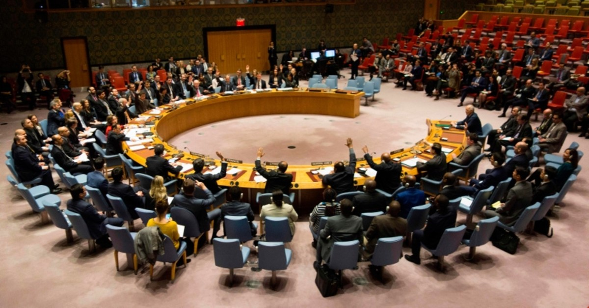 This file photo shows members of the Security Council voting during a United Nations Security Council meeting on a ceasefire in Syria, February 24, 2018 in New York. (AFP Photo)