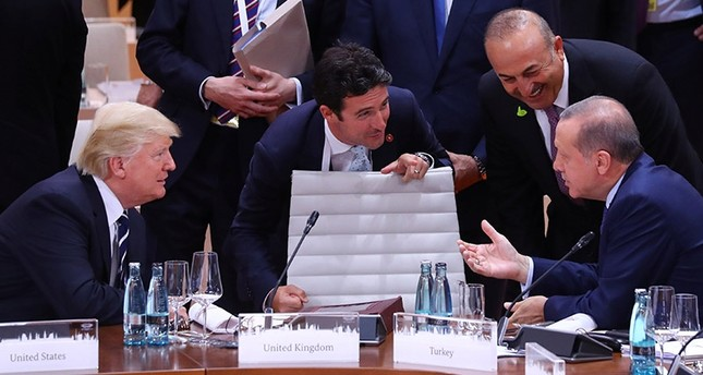U.S. President Donald Trump, Interpreter Emrah Kale, President Recep Tayyip Erdoğan and Foreign Minister Mevlüt Çavuşoğlu talk during the working session at the G20 leaders summit in Hamburg, Germany, July 7, 2017. (Reuters Photo)