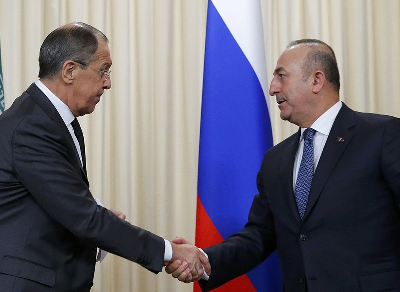Foreign Minister Mevlu00fct u00c7avuu015fou011flu (R) and Russian counterpart Sergei Lavrov (L), leave after a news conference in Moscow, Russia, Dec. 20, 2016 (Reuters File Photo)