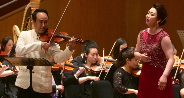 South Korean Violinist Won Hyung Joon and his North Korean soprano partner, Kim Song Mi perform at the Shanghai Oriental Arts Center in Shanghai on Sunday, May 12, 2019. (AP Photo)