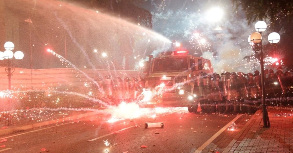 Anti-government supporters throw flares towards police during a protest in Tirana, Albania, June 2, 2019.