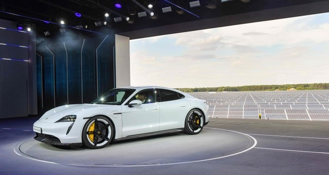 The Porsche Taycan electric car is displayed during the world premiere on September 4, 2019 in a hall of the airfield of Neuhardenberg, in front of a photovoltaic power plant. AFP Photo