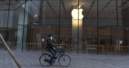 Apple warns coronavirus will cut iPhone production, sales