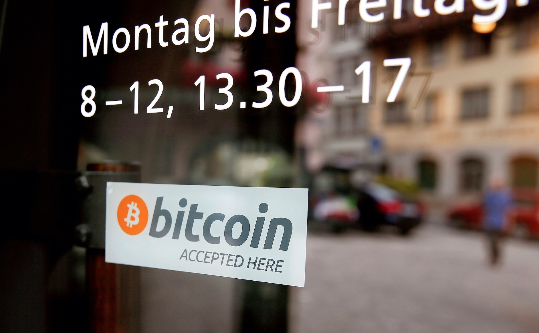 A sticker that reads u201cBitcoin accepted hereu201d is displayed at the entrance of the Stadthaus town hall  in Zug, Switzerland, August 30, 2016.