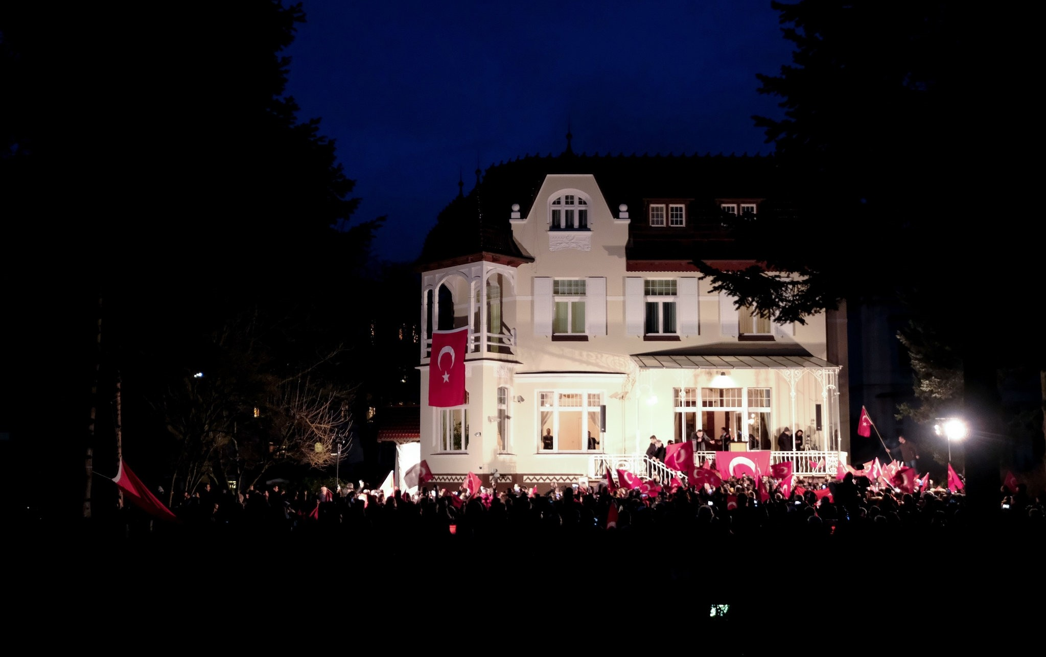 Turkish people gathering at the residence of Turkey's consul general in Hamburg to protest the German gov't after Turkish Foreign Minister Mevlu00fct u00c7avuu015fou011flu's meeting on the upcoming referendum in Hamburg was cancelled by German officials, March 7.