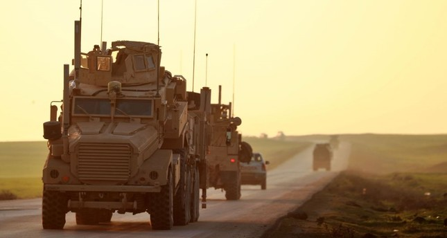 U.S. Marine Corps tactical vehicles are seen driving along a road near the town of Tal Baydar in the countryside of Syria's northeastern Hasakeh province, Dec. 21.