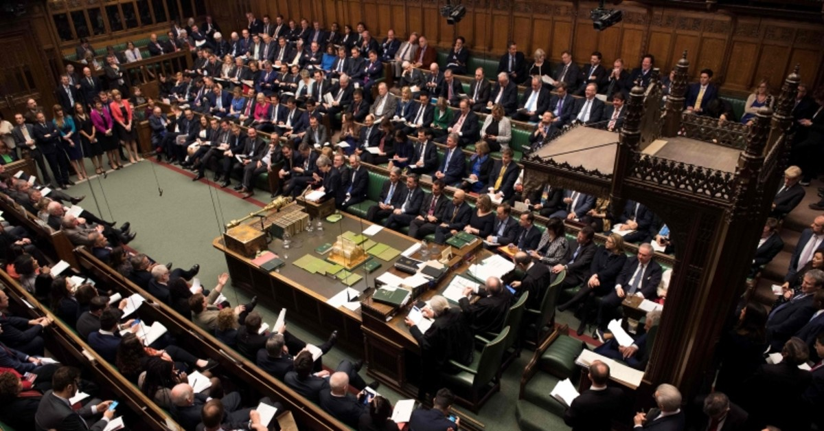 A handout photograph taken and released by the UK Parliament on March 27, 2019 shows May standing at the dispatch box and speaking during the weekly Prime Minister's Questions (PMQs) question and answer session in the House of Commons in London.