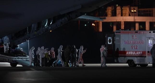 Evacuees from China disembark the plane, Ankara, Feb. 1, 2020. AA Photo