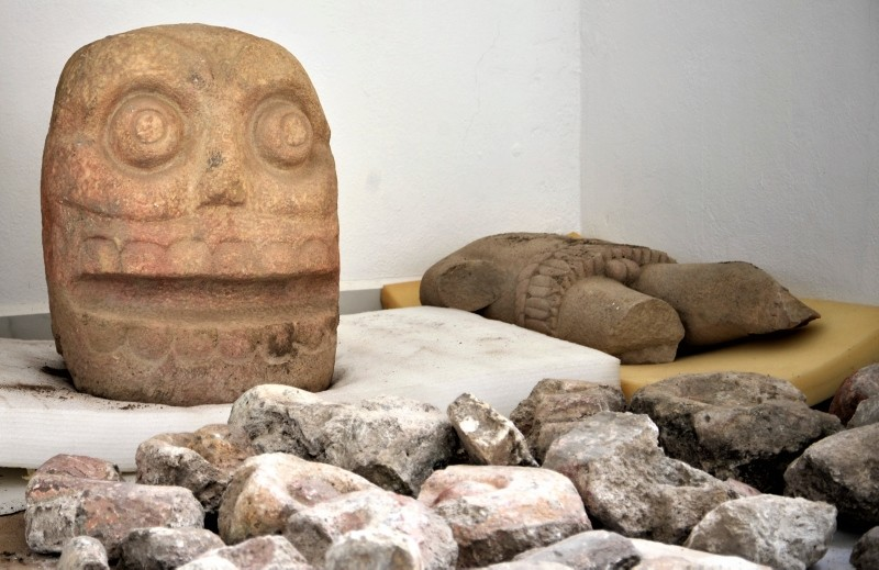 A skull-like stone carving depicting the Flayed Lord stored after being excavated from the Ndachjianu2013Tehuacan archaeological site in Tehuacan, Puebla state, where archaeologists have discovered the first temple dedicated to the deity. (AP Photo)