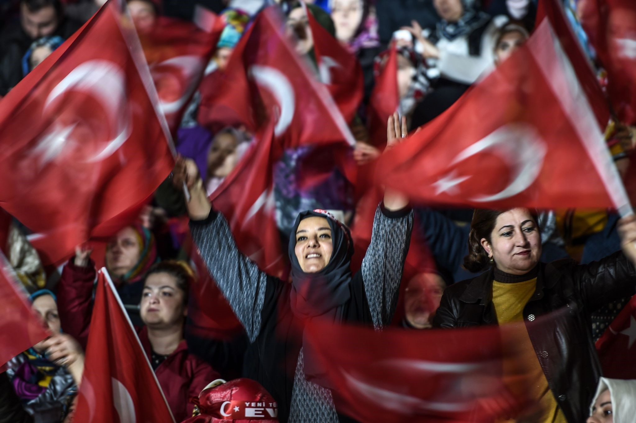 Women wave Turkish flags at the event which was also attended by Erdou011fan and prominent womenu2019s NGOs representatives.