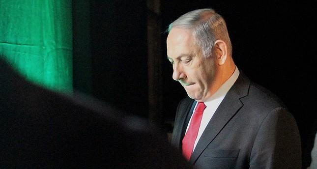 Israeli Prime Minister Benjamin Netanyahu leaves the Muni World conference in Tel Aviv on February 14, 2018. (AFP Photo)
