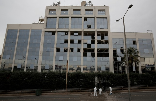 Forensic experts search for evidence after a bomb blast outside the Greece's SKAI TV building in Athens, Greece December 17, 2018. (Reuters Photo)