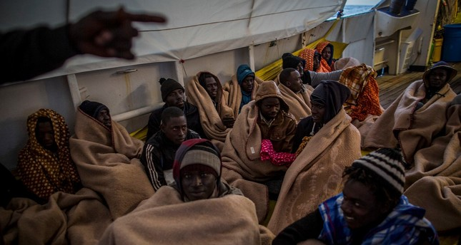 Refugees and migrants rest aboard Golfo Azzurro after being rescued about 13 miles north of Sabratha, Libya, on Saturday, March 4, 2017. (AP Photo)