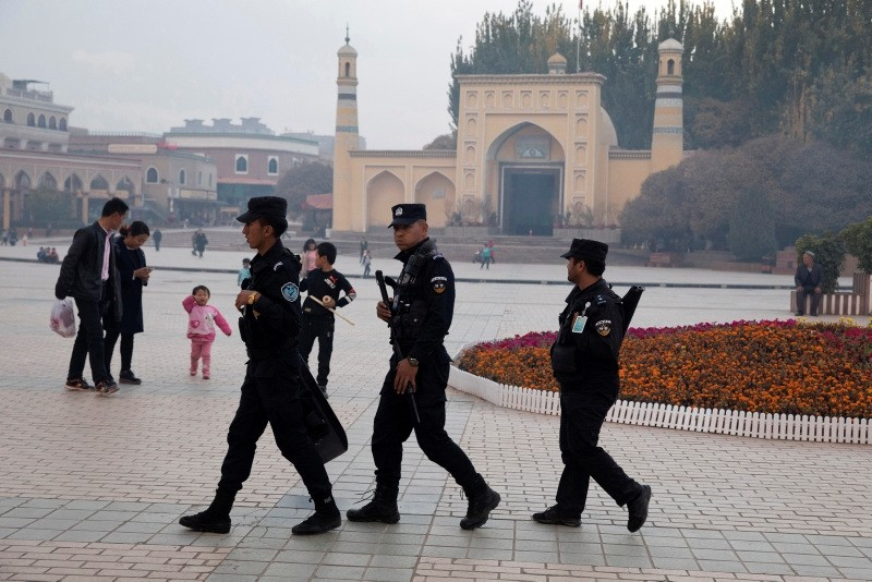 Uighur security personnel patrol near the Id Kah Mosque in Kashgar in western China's Xinjiang region. (AP Photo)
