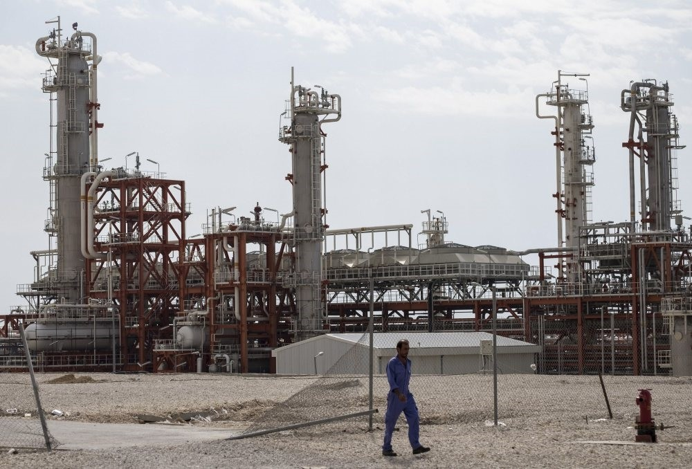 An Iranian worker walks at a unit of South Pars Gas field in Asalouyeh Seaport, north of Persian Gulf.