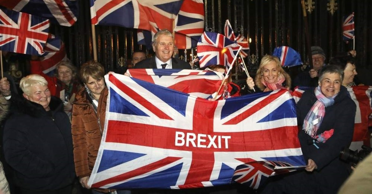Brexit supporters celebrate during a rally outside Stormont, Belfast, Jan. 31, 2020. (AP Photo)