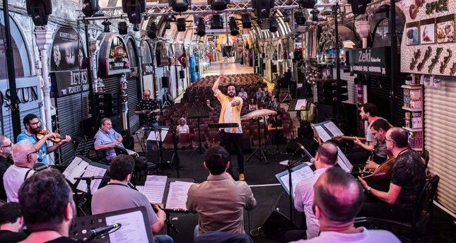 Melodies of Istanbul orchestra perform during a rehearsal ahead of the 46th edition of Istanbul Music Festival at the Grand Bazaar, exceptionally open on a Sunday, during an interview with AFP on June 3, 2018 in Istanbul. (AFP Photo)