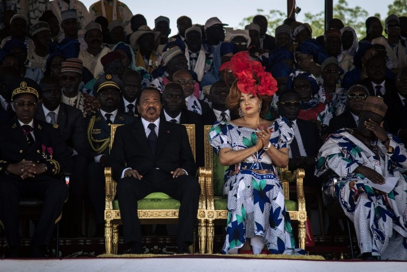 In this file photo taken on September 29, 2018 Cameroonian President Paul Biya and his wife, Chantal Biya, listen to speeches in honour of Biya's reign during an election rally at the Maroua Stadium, in the Far North Region of Cameroon. (AFP Photo)