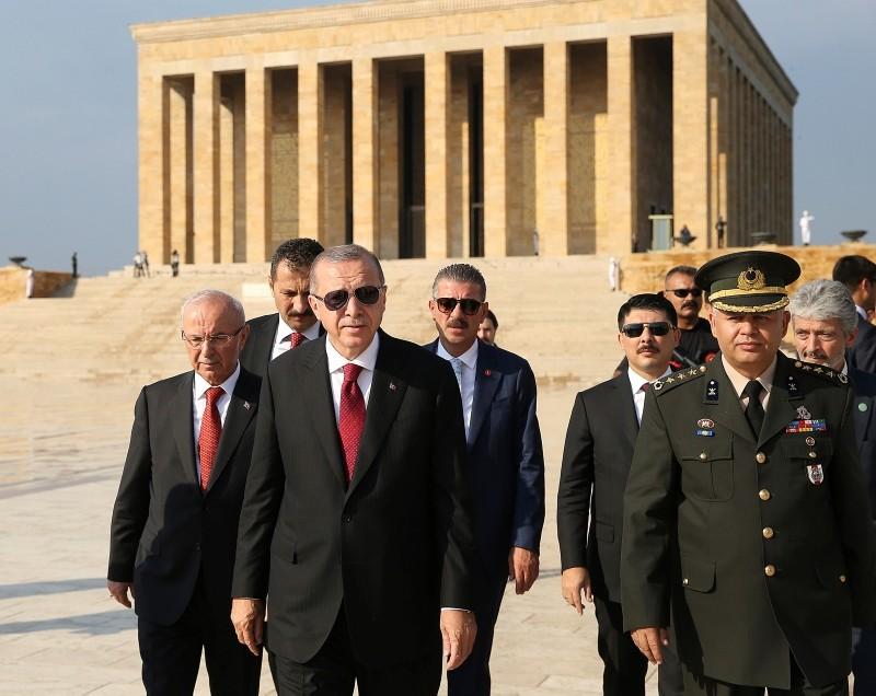 Erdoğan walks following a wreath-laying ceremony at Anıtkabir in Ankara, Turkey, Monday, July 9, 2018.