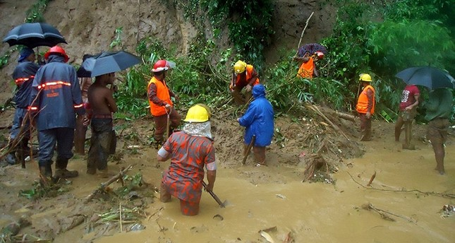 Bangladeshi fire fighters search for bodies after a landslide in Bandarban on June 13, 2017. (AFP Photo)
