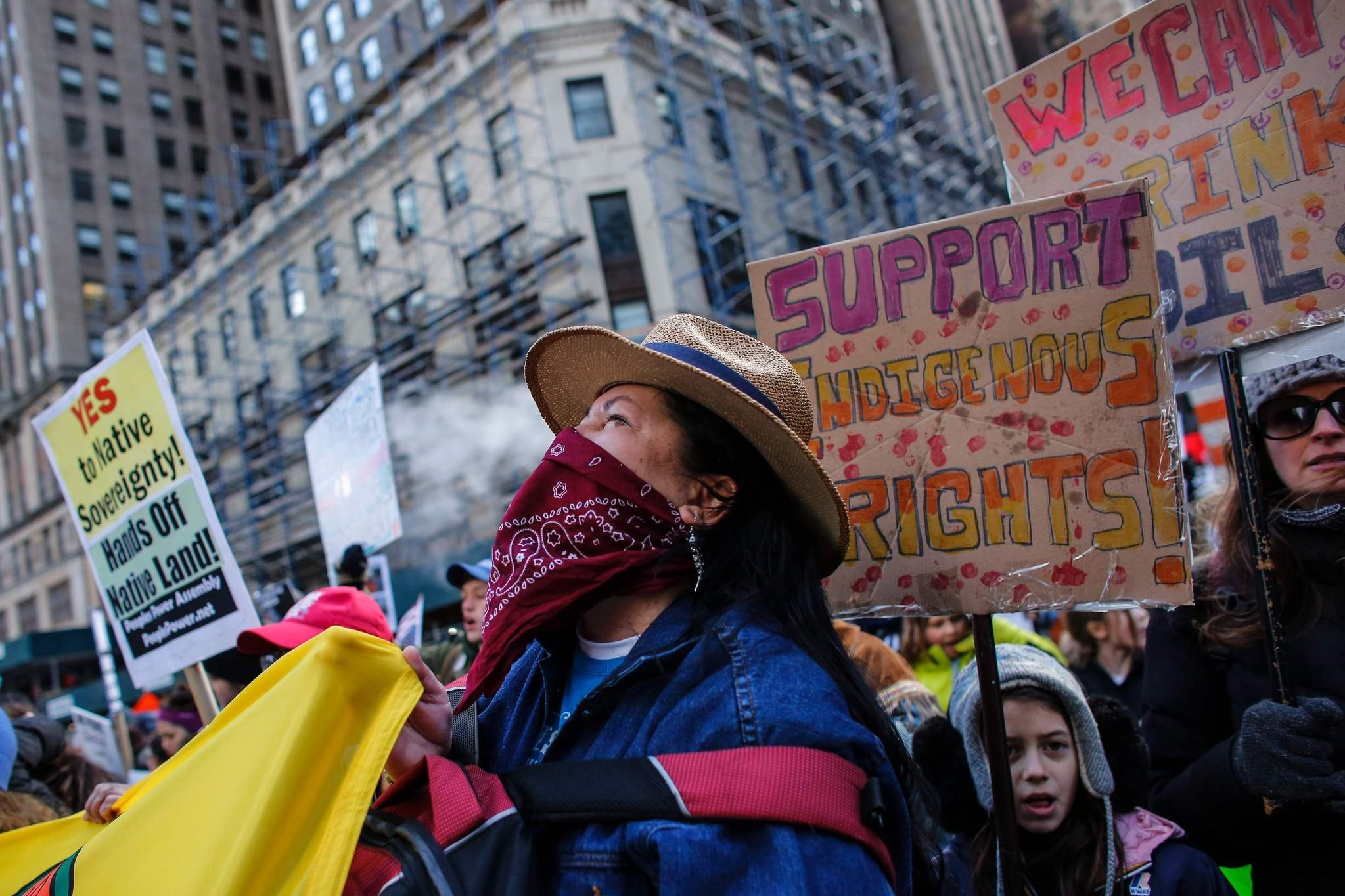 A woman shouts slogans as she takes part during a protest against the planned Dakota Access Pipeline on March 04, 2017 in New York. (AFP Photo)