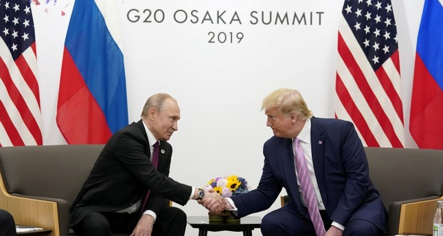 Russia's President Vladimir Putin and U.S. President Donald Trump shake hands during a bilateral meeting at the G20 leaders summit in Osaka, Japan, June 28, 2019. (Reuters Photo)