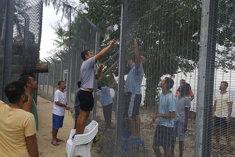 An undated image released on November 1, 2017 shows detainees fixing a perimeter fence at the Manus Island detention center in Papua New Guinea (Reuters Photo)
