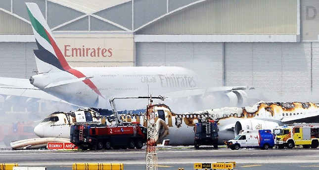 An Emirates airlines Boeing 777-300 A6-EMW plane flight number EK521 from Trivandrum to Dubai lays on the ground in Dubai airport after being gutted by fire due to a mechanical failure at Dubai international airport (EPA Photo)