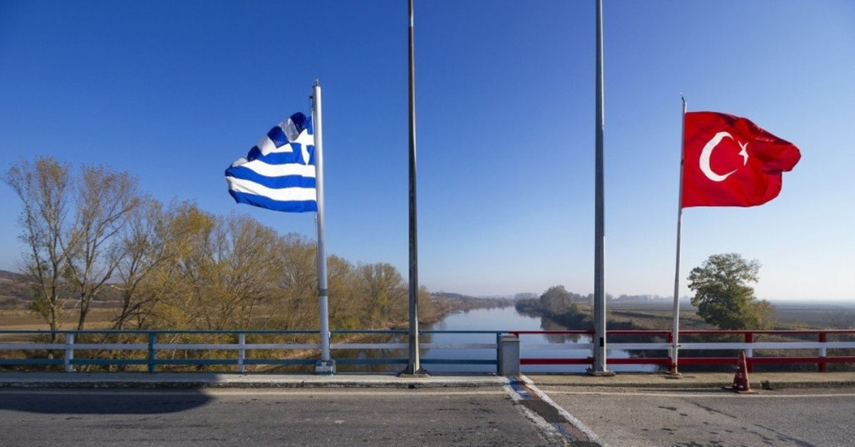 Turkish and Greek flags fly on a bridge over the Meriu00e7 River that divides the two countries. Greece has been a favored destination of FETu00d6 members fleeing justice.