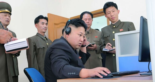 North Korean Supreme Leader Kim Jong-un uses a computer during field guidance (AFP Photo)