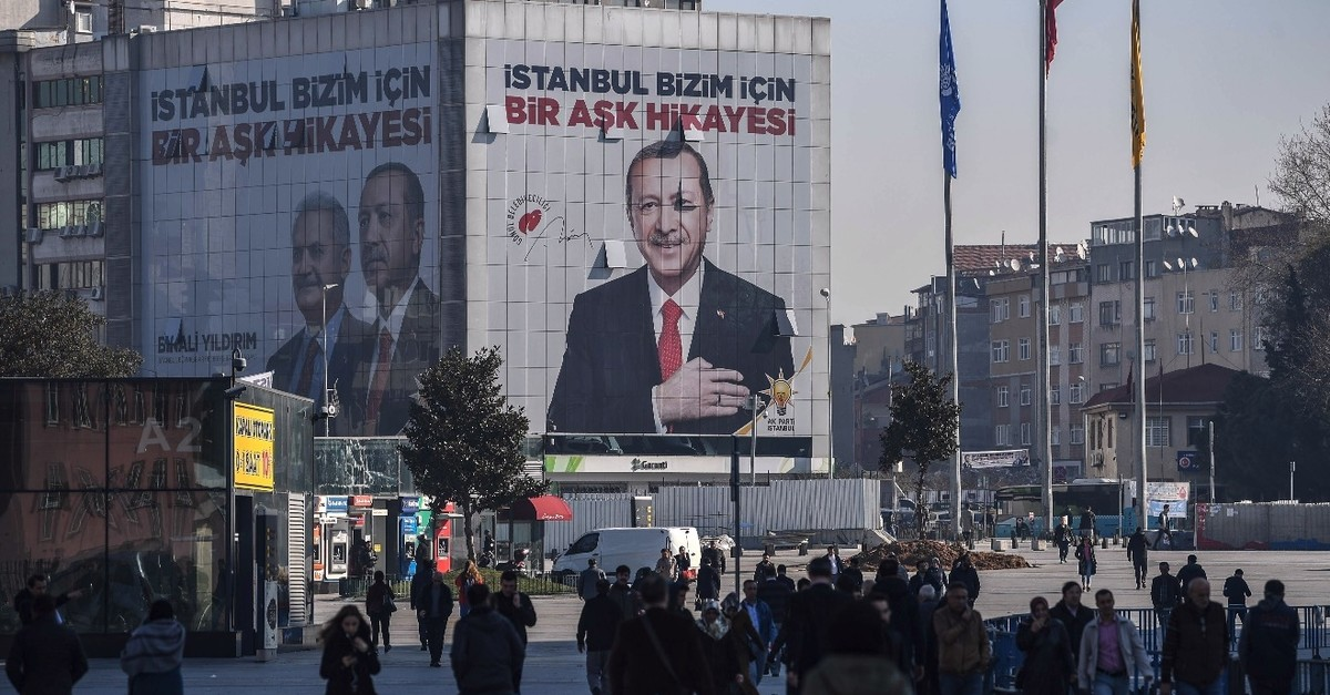 A giant campaign poster for local elections bearing a picture of President Erdou011fan and reading u201cIstanbul Is a Love Story For Usu201d covers the facade of a building, March 26, 2019.