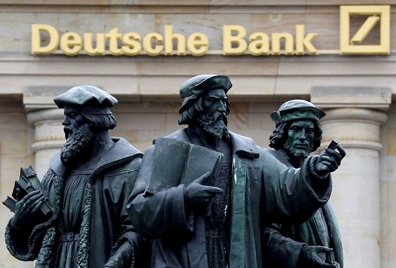 A statue is pictured next to the logo of Germany's Deutsche Bank in Frankfurt, Germany September 30, 2016. (Reuters Photo)