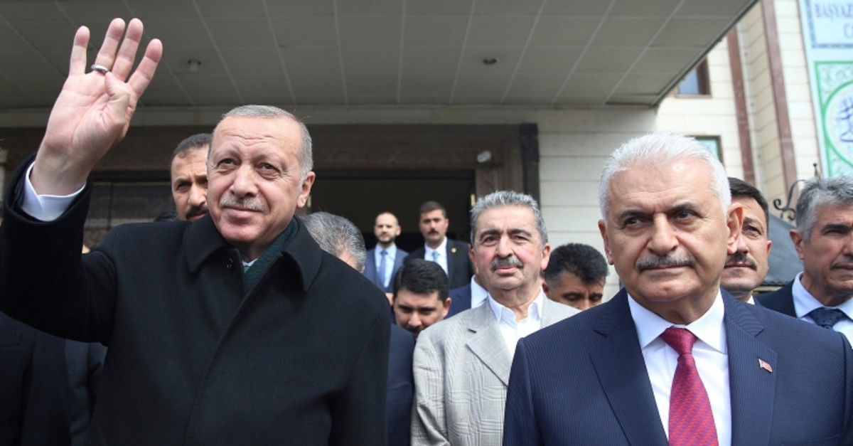 President Recep Tayyip Erdou011fan, left, is flanked by the ruling Justice and Development Party (AK Party)'s mayoral candidate for Istanbul, Binali Yu0131ldu0131ru0131m, waves after Friday prayers, in Ankara, Turkey, Friday, April 12, 2019. (AP Photo)