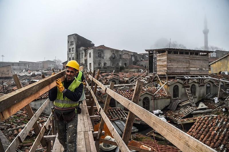 A worker carrying planks on the top of Istanbul's iconic marketplace, the Grand Bazaar, during its renovation in Istanbul. (AFP Photo)