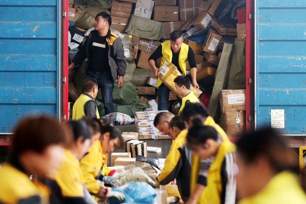 Employees sort packages ahead of Singles Day in Huaibei, China's eastern Anhui province.