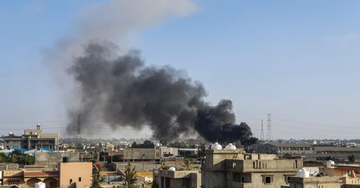 This picture taken on June 29, 2019 shows smoke plumes rising in Tajoura, south of the Libyan capital Tripoli, following a reported airstrike by forces loyal to retired general Khalifa Haftar. (AFP File Photo)
