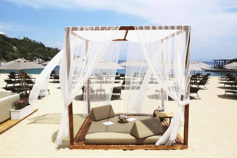 The Sands Beach Club is a summer venue with cream-colored parasols, stylish chaise lounges made of walnut and private lodges full of linen pillows just a few of the details, creating complete French elegance.